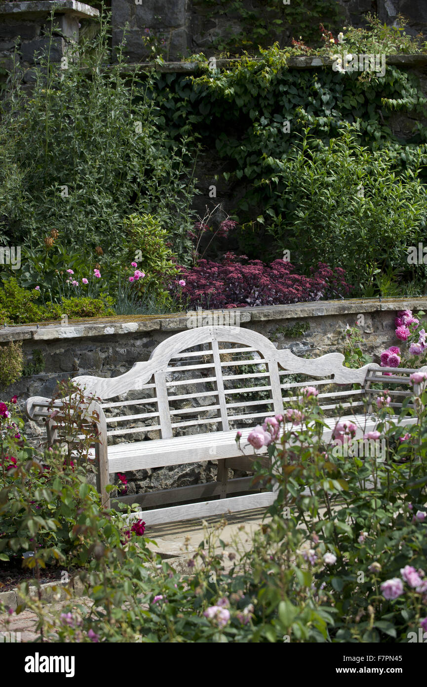 Garden bench at Bodnant Garden, Clwyd, Wales. Created by five generations of one family, Bodnant sits perfectly - Stock Image