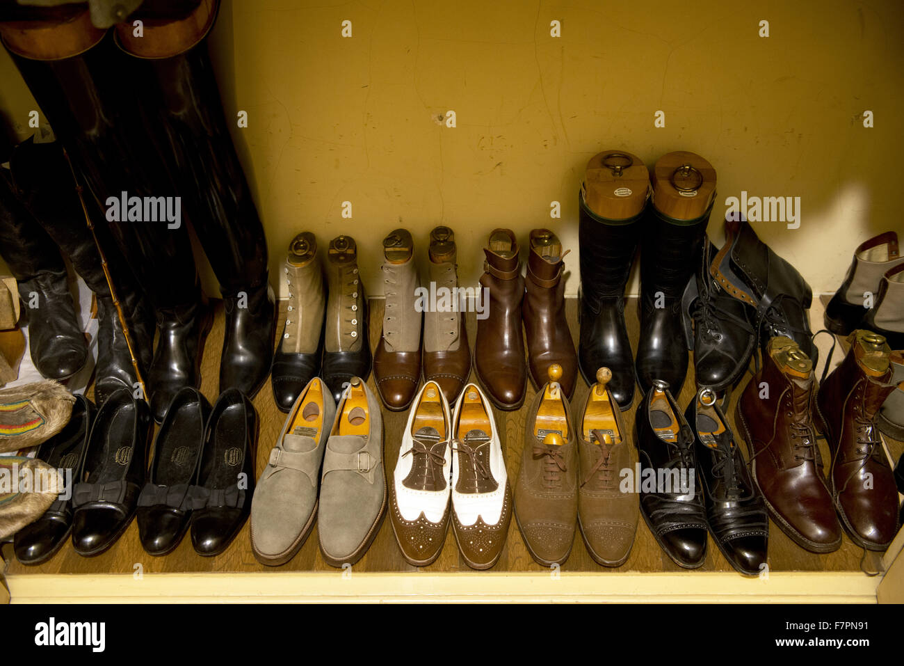 A collection of shoes at Anglesey Abbey, Gardens and Lode Mill, Cambridgeshire. - Stock Image