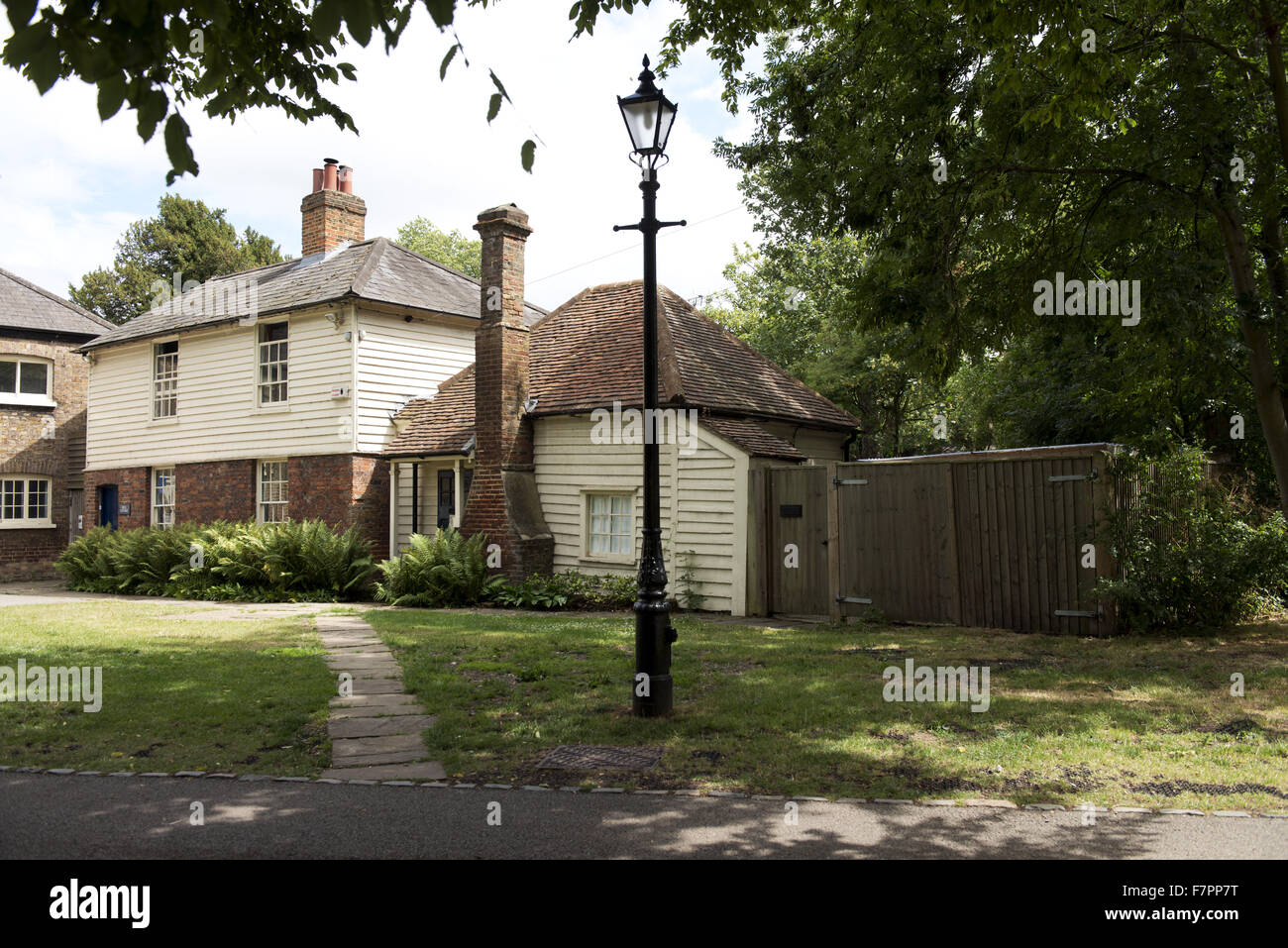 Mill Cottage, Morden Hall Park, London. To the left of the cottage is the old Snuff Mill. Stock Photo