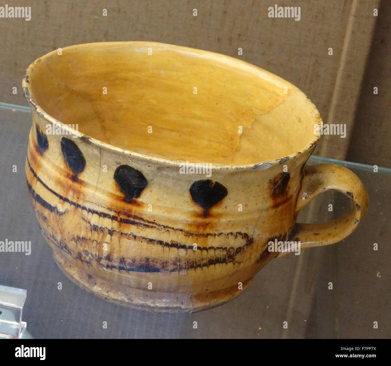 Lead-glazed earthernware mug. Dated 17th Century - Stock Image