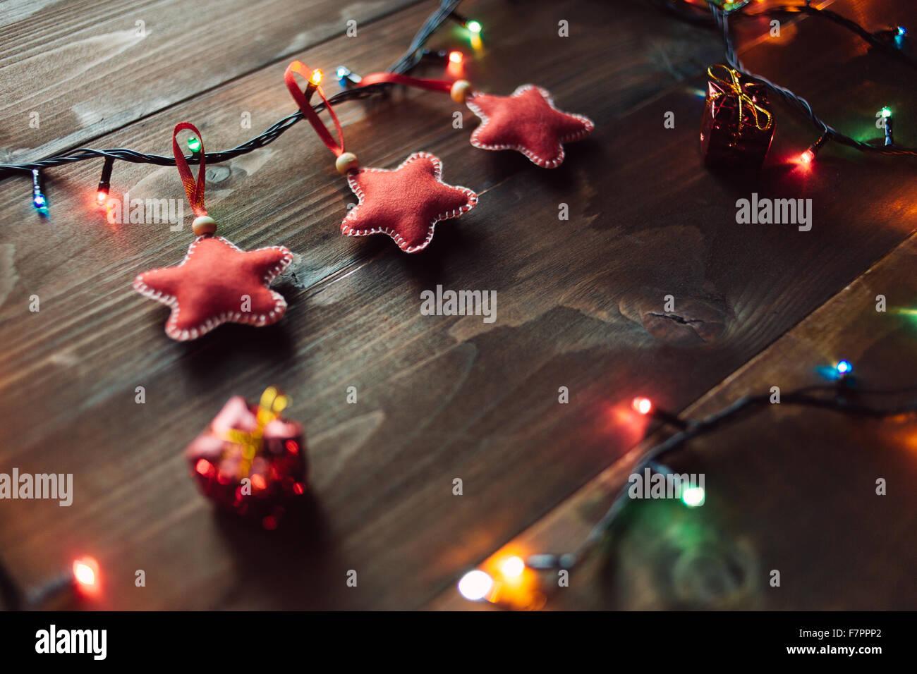 Handmade red stars with garland lights - Stock Image