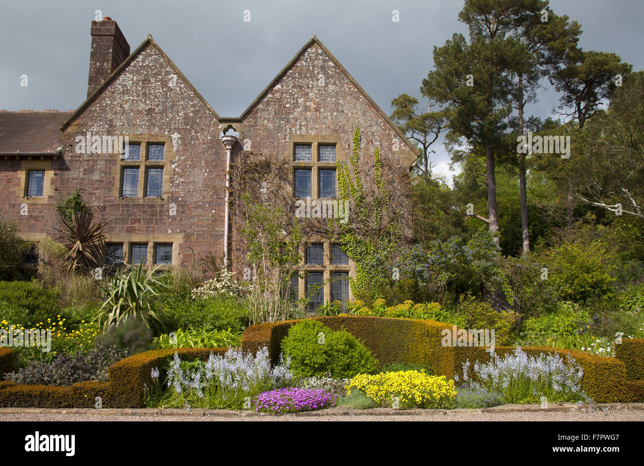 The house and gardens at Knightshayes, Devon. Knightshayes is a spectacular Gothic Revival house set in glorious - Stock Image