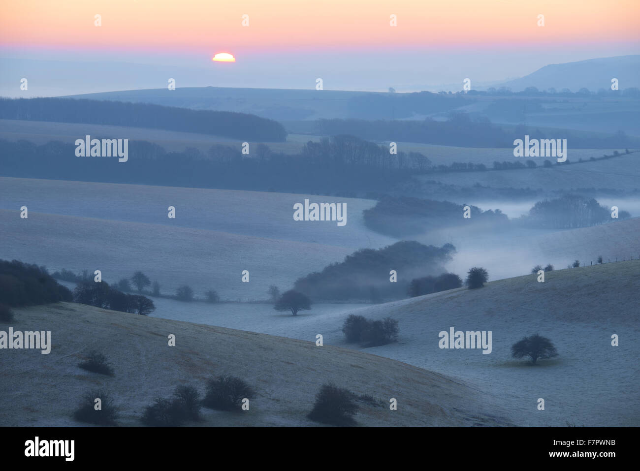A misty view across the Sussex Downs at dawn, from Ditchling Beacon, East Sussex. Stock Photo