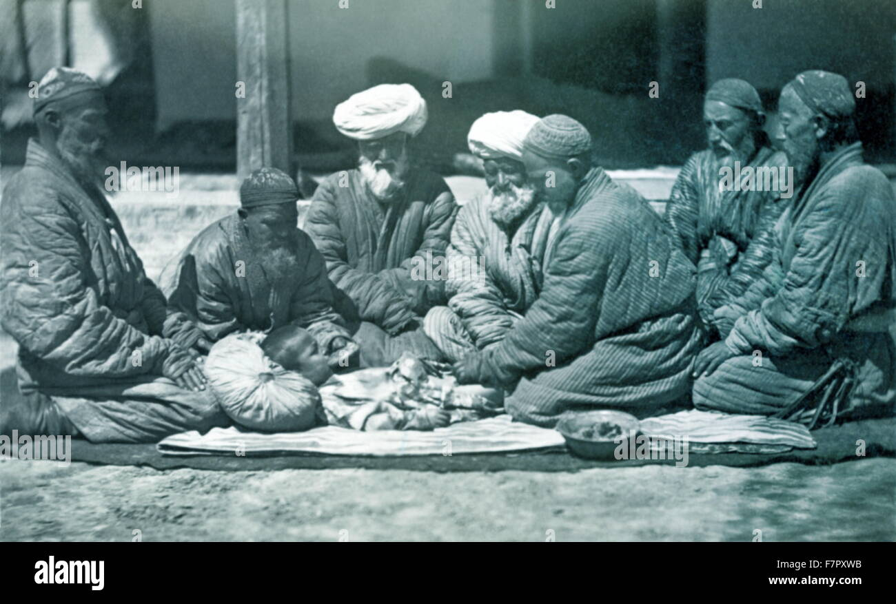 circumcision performed in the Russian Empire's Moslem regions (Turkmenistan circa 1875 - Stock Image