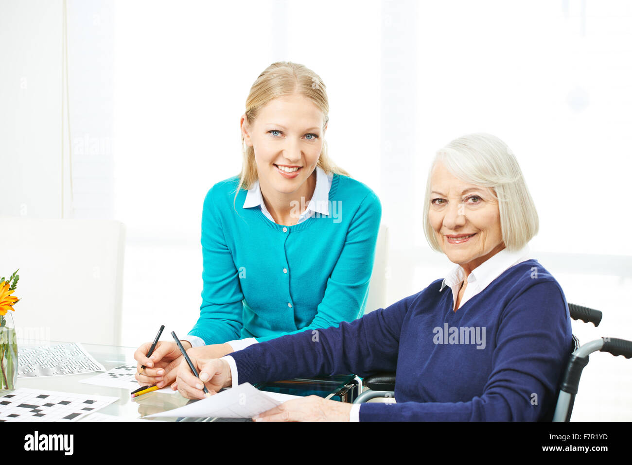 Family doing memory training together with mazes and sudoku puzzles - Stock Image