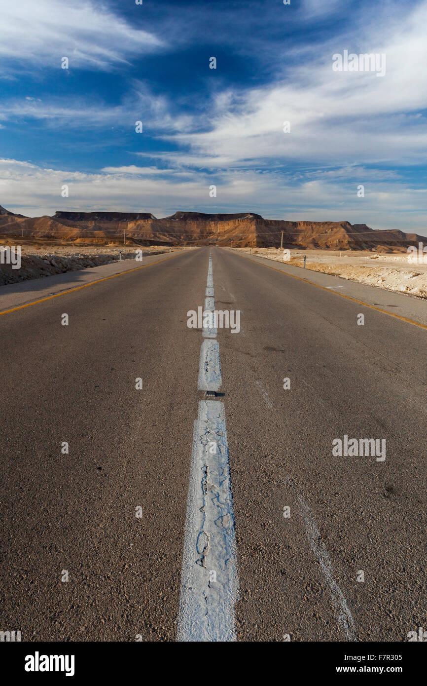A desert road in the Negev desert, Israel - Stock Image