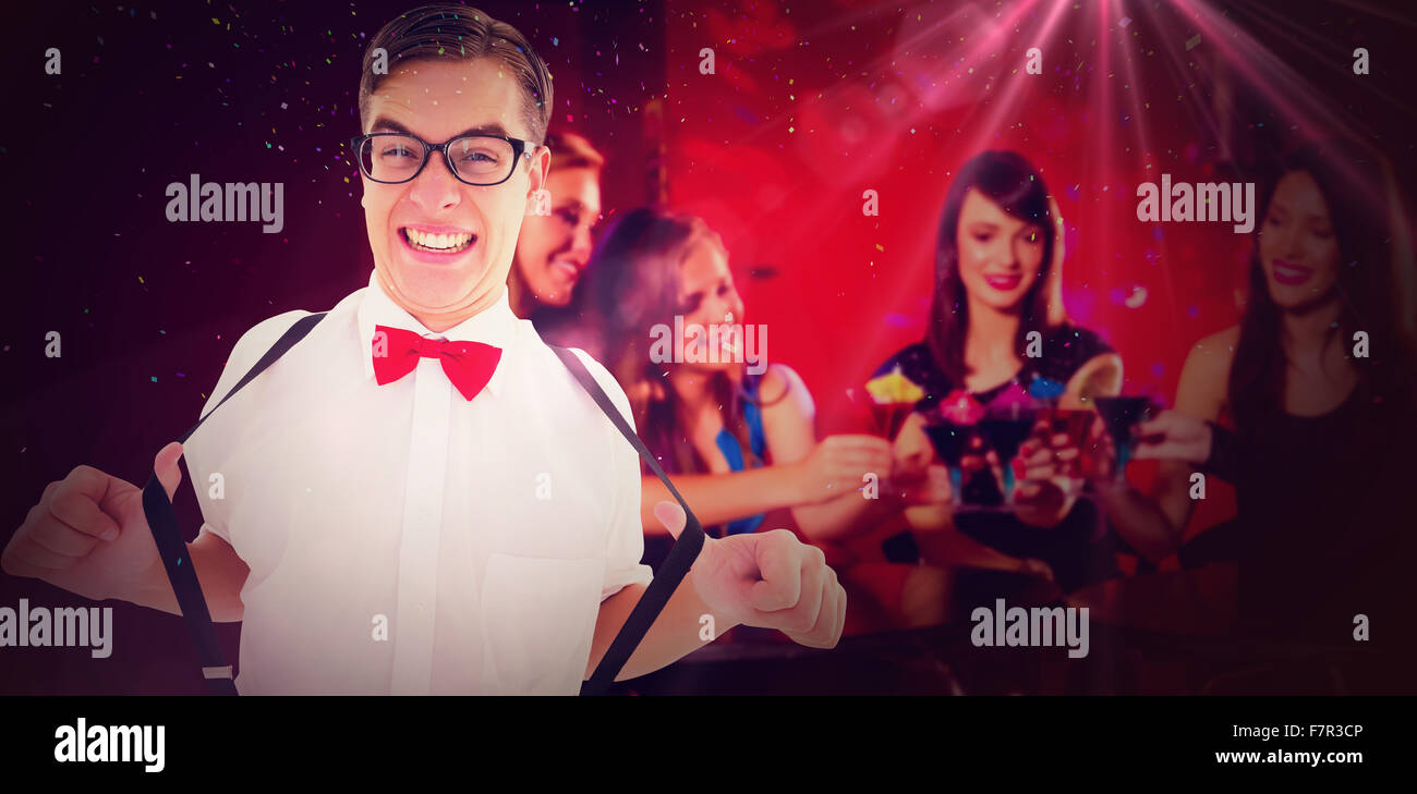 Composite image of geeky hipster pulling his suspenders - Stock Image