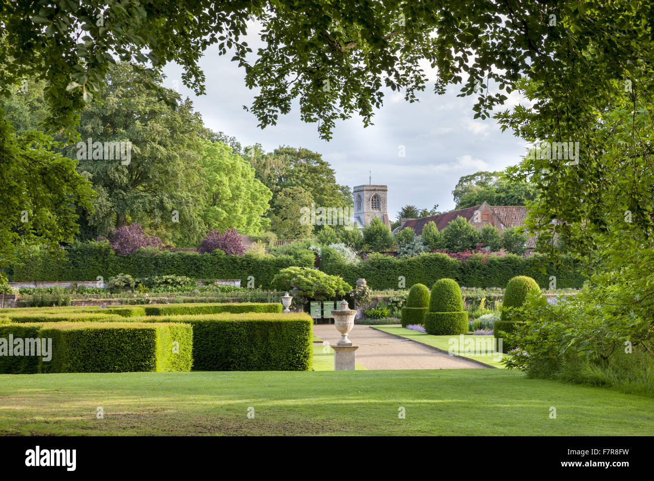 The garden, with St Andrew's Church in the background, at Blickling Estate, Norfolk. Blickling is a turreted - Stock Image