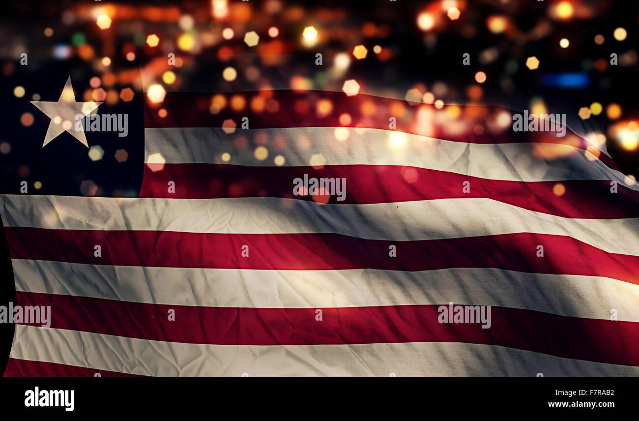 Liberia National Flag Light Night Bokeh Abstract Background - Stock Image