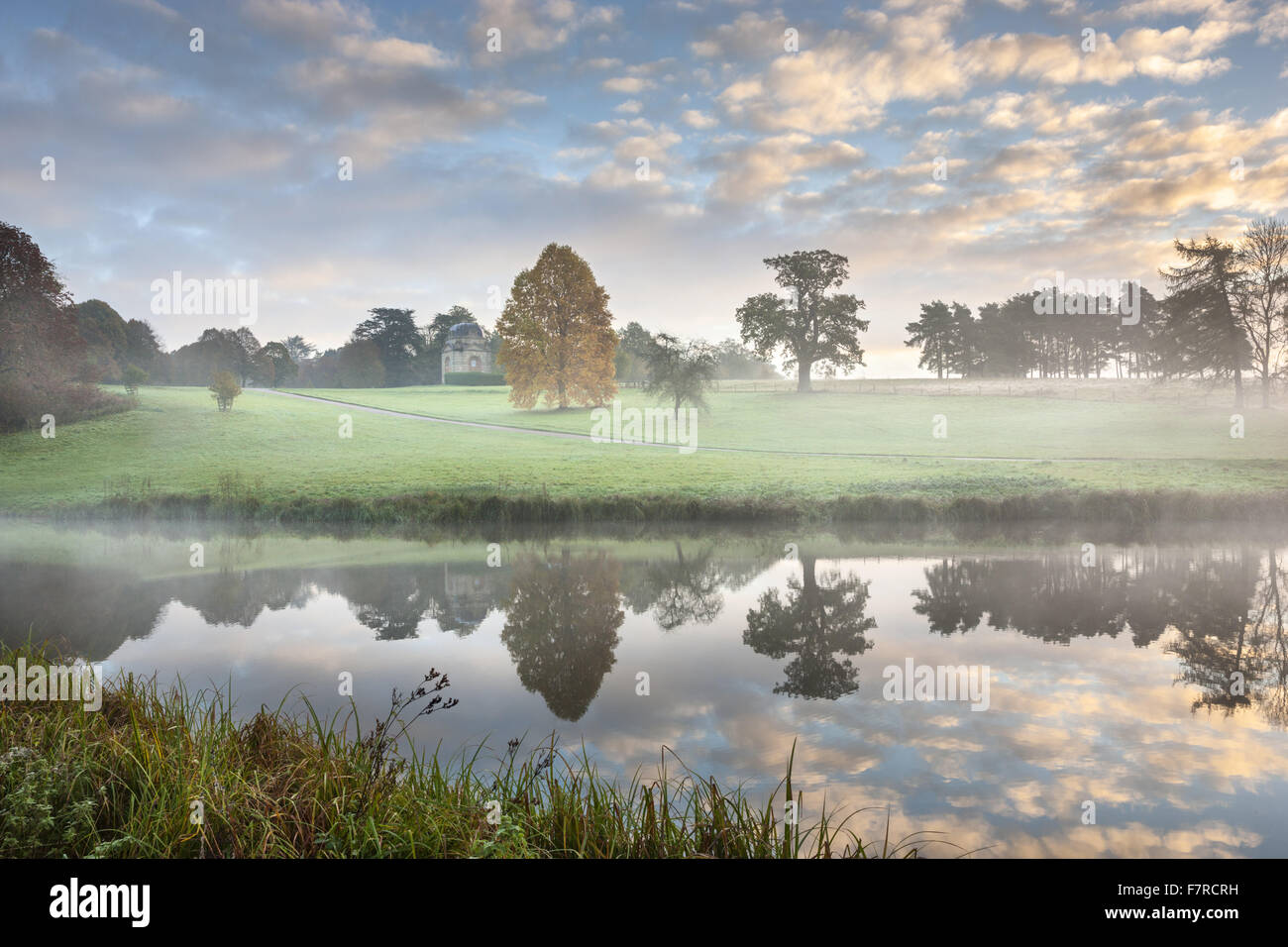A lake at Stowe, Buckinghamshire. Stowe is an 18th century landscaped garden, and includes more than 40 historic - Stock Image