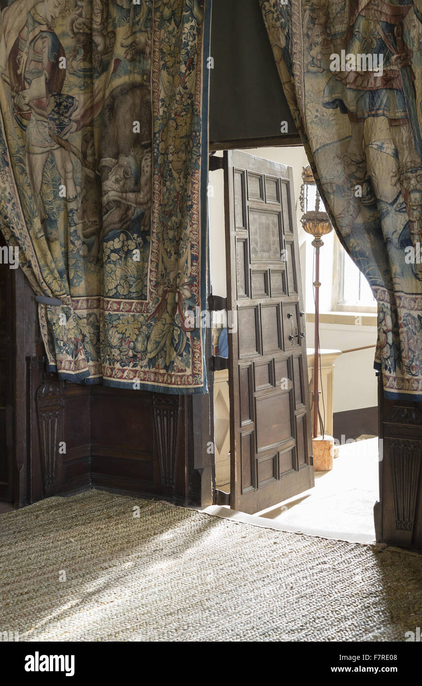 Draped tapestries framing an open door in the Great High Chamber, Hardwick House, Derbyshire. The walls of the Long - Stock Image