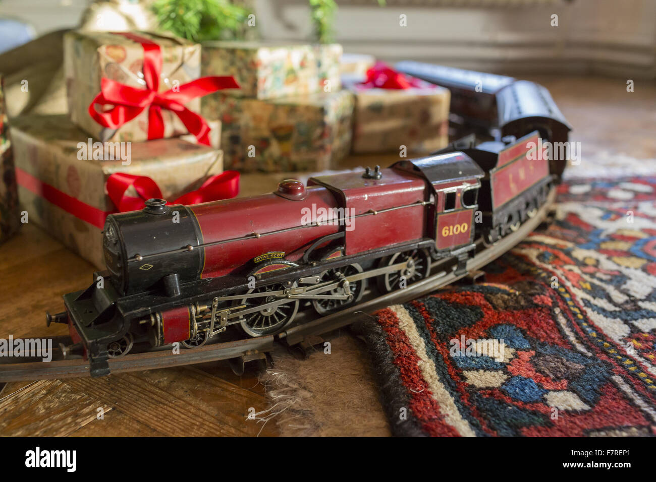 Christmas Model Railway.Christmas Gifts And A Model Train On A Circular Track On
