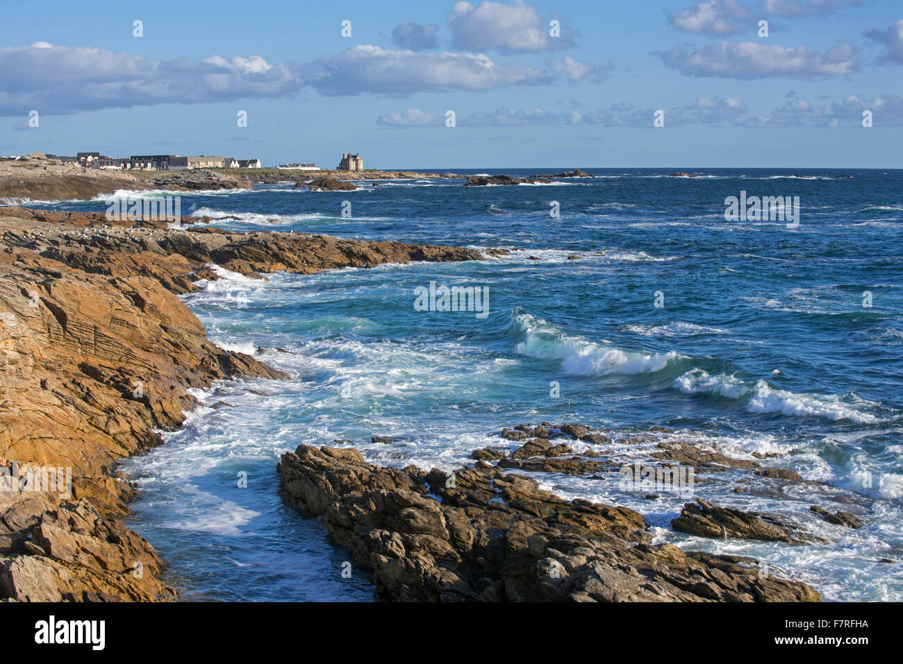 Coastline of the Côte Sauvage and château Turpault at Quiberon, Morbihan, Brittany, France - Stock Image