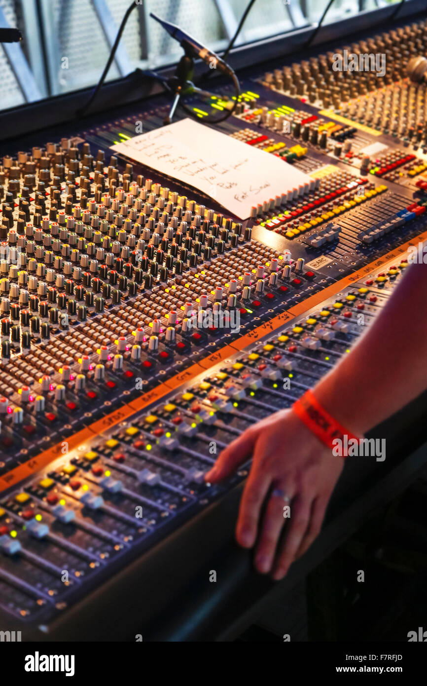 Knobs and slide controls of mixing console / audio mixer at concert - Stock Image