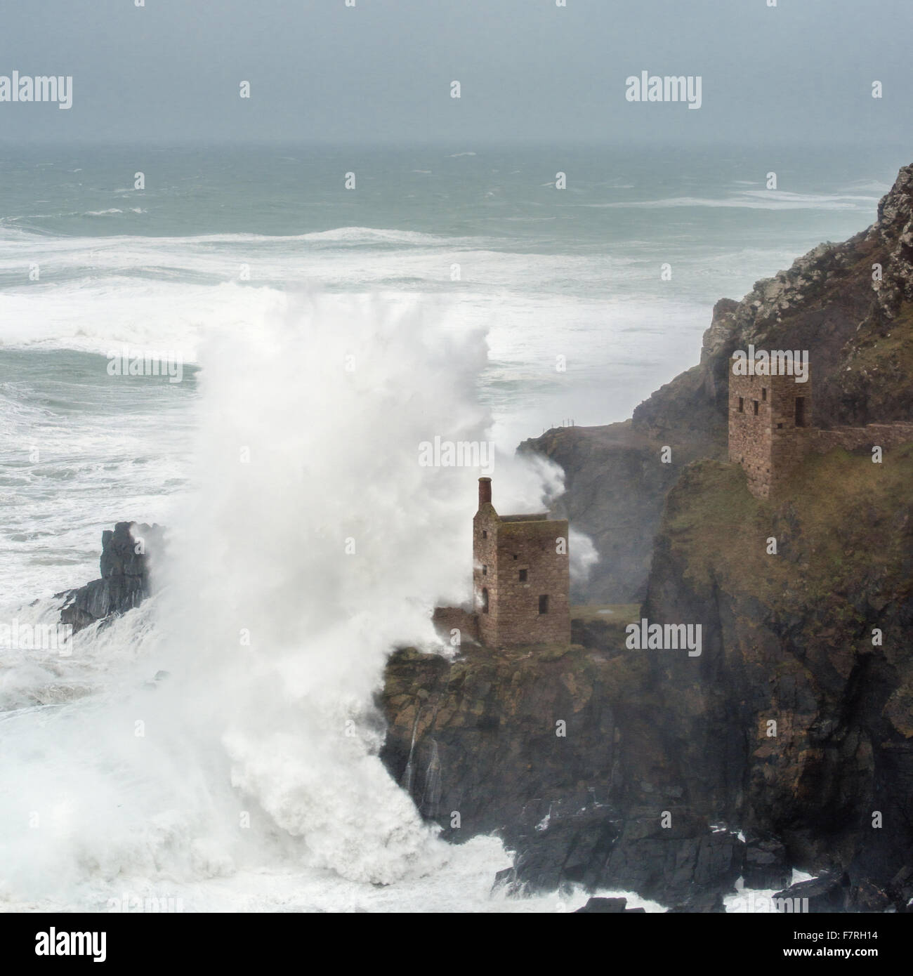 A storm at sea near the Crown Engine Houses, Cornwall. The lower of the two engine houses was built in 1835 to pump - Stock Image