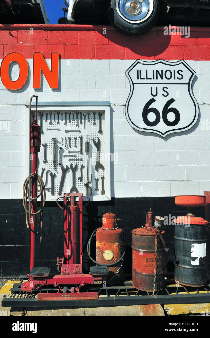 Vintage air pumps, tools and other equipment at a garage and towing service on the old historic US Route 66 route. - Stock Image