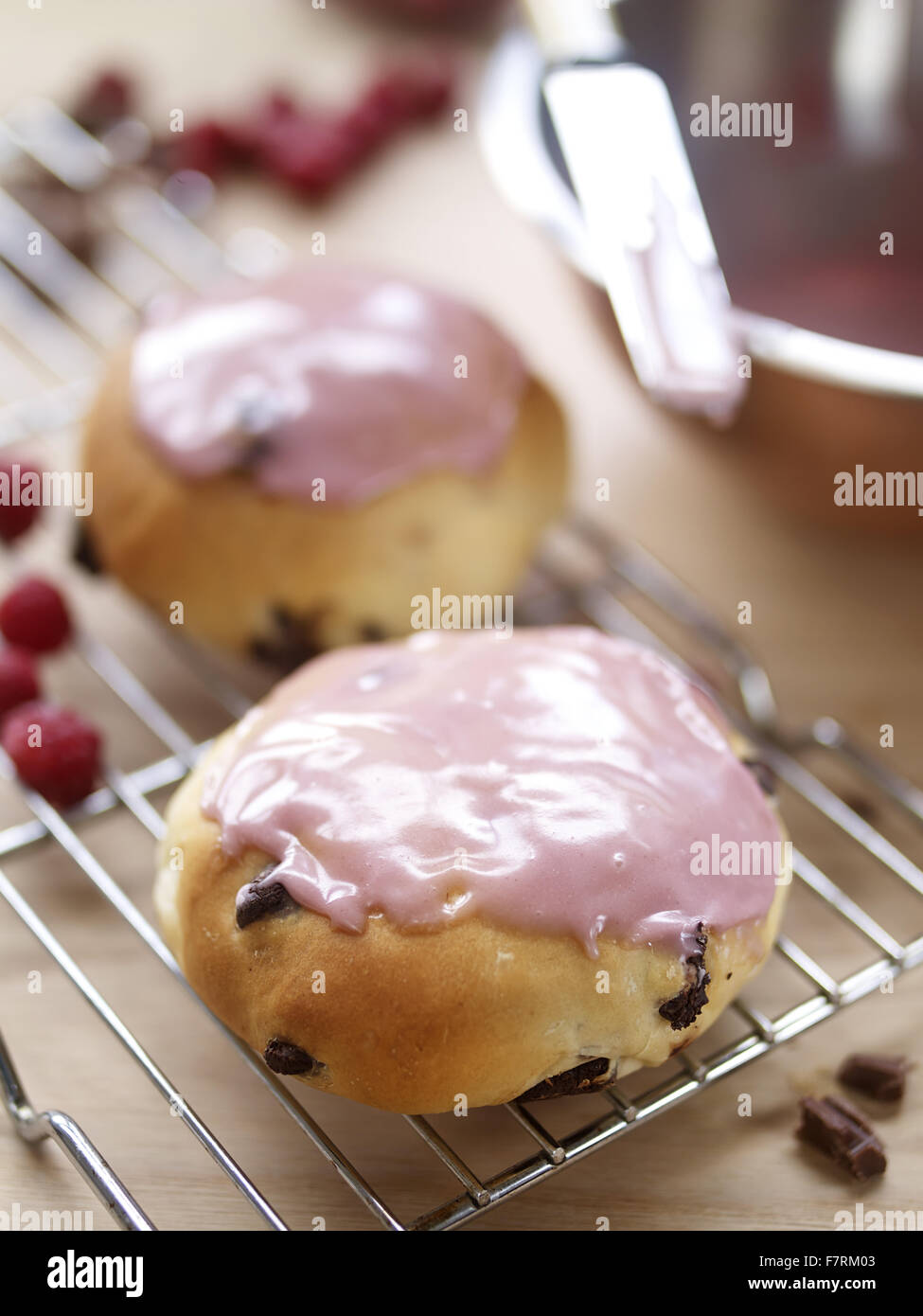 Iced buns photographed for the 2015 National Trust Summer Cookbook. - Stock Image