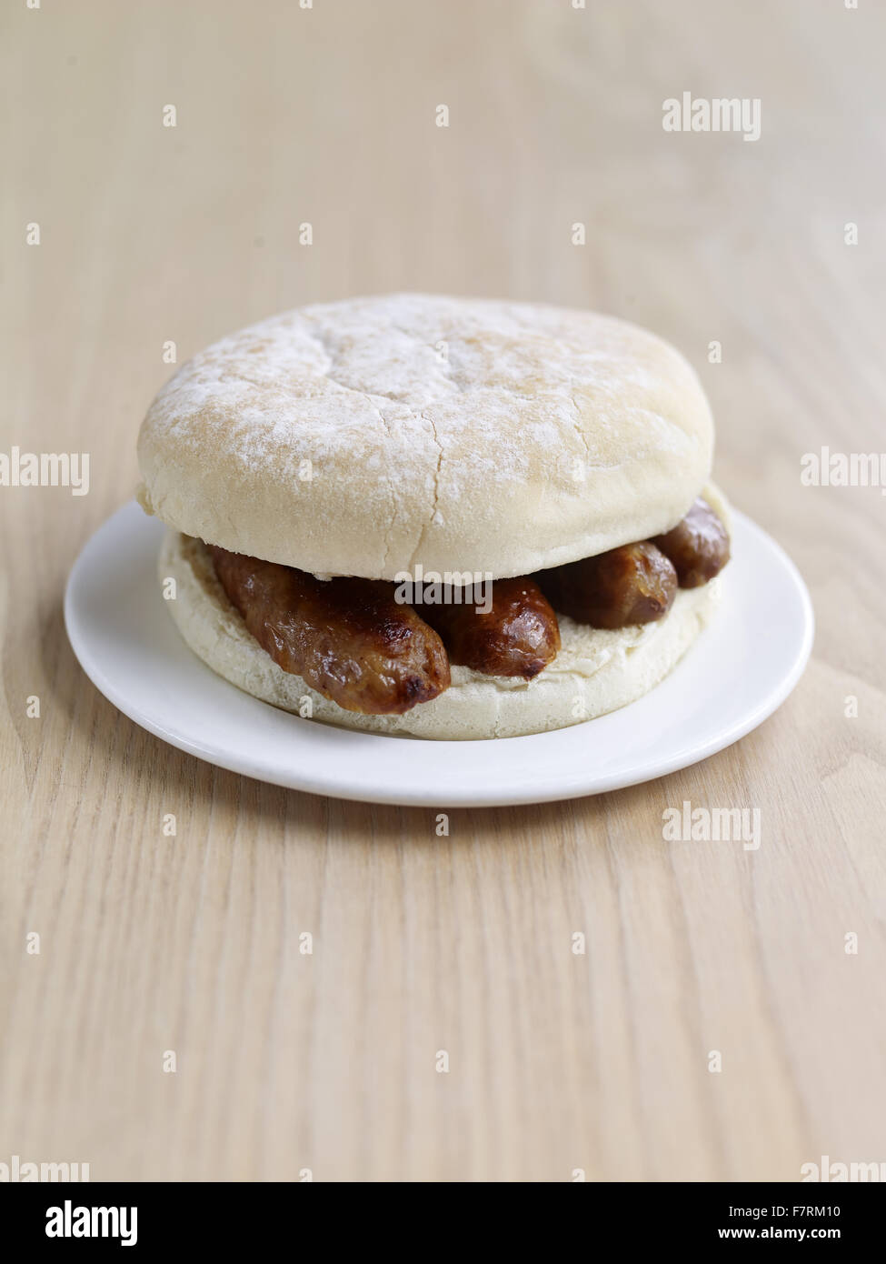 Sausage bap photographed for the 2015 National Trust Summer Cookbook. - Stock Image