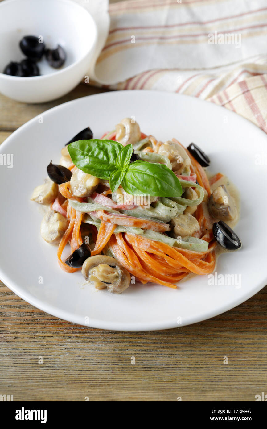 color pasta with mushrooms and olive, food closeup - Stock Image
