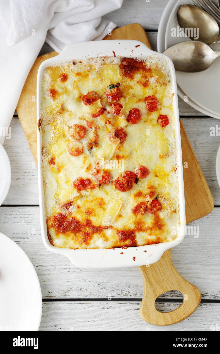 lasagna with cheese in baking dish, top view - Stock Image