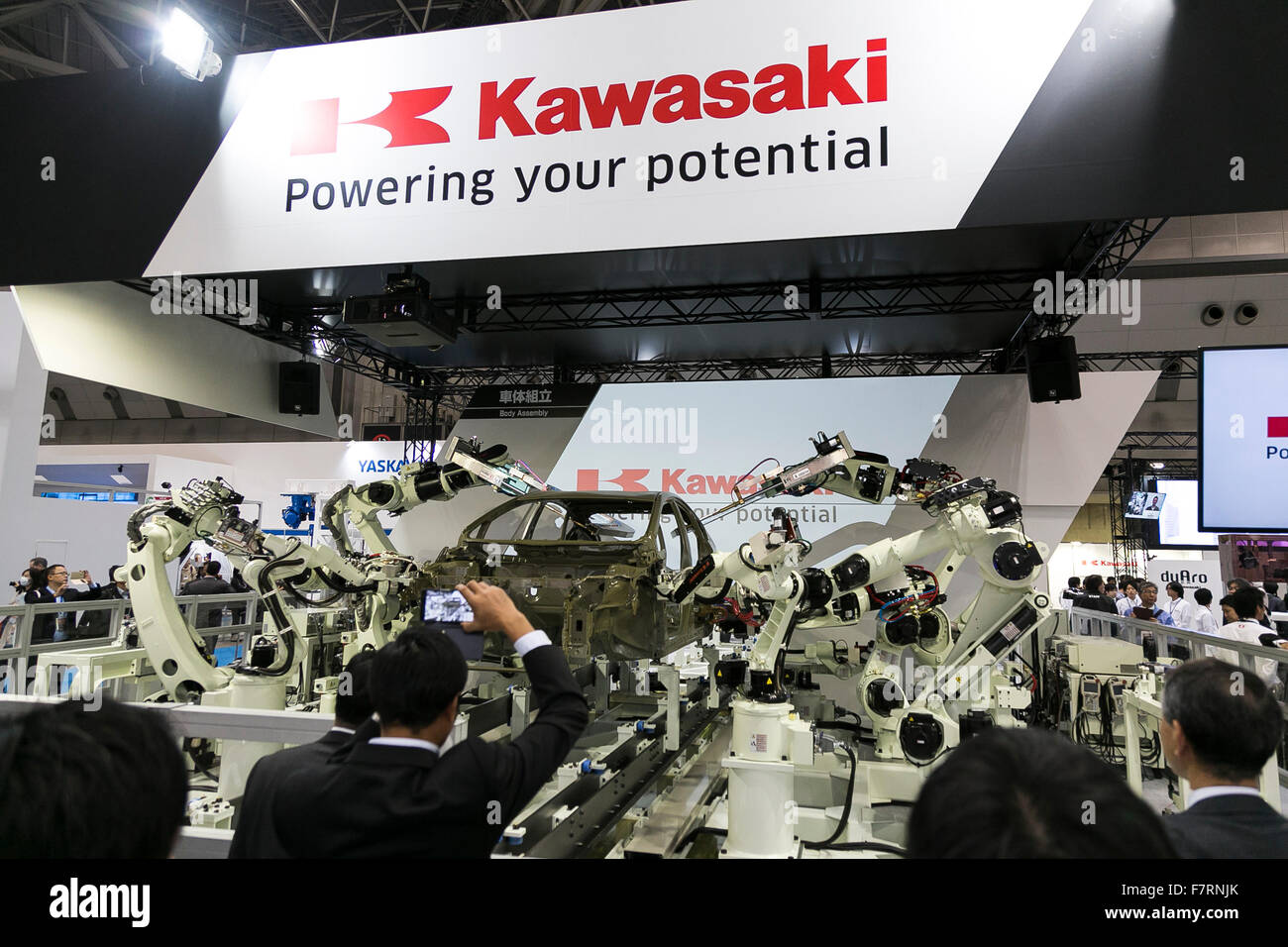Kawasaki Heavy Industries Ltd.'s body assembly robots perform at the International Robot Exhibition 2015 on December Stock Photo