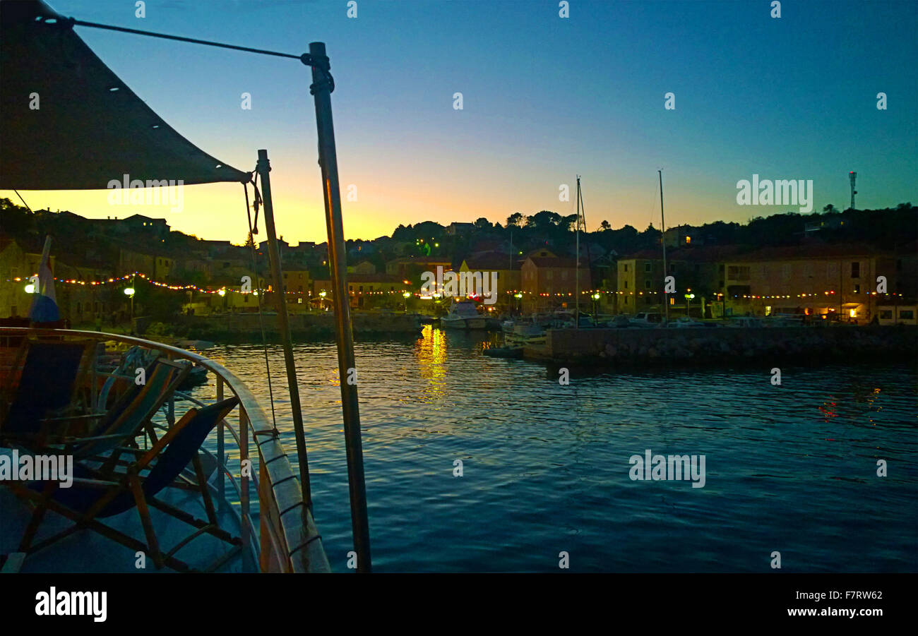 Croatia, view of Sali harbor by night on Dugi Otok island from a cruise ship anchored - Stock Image