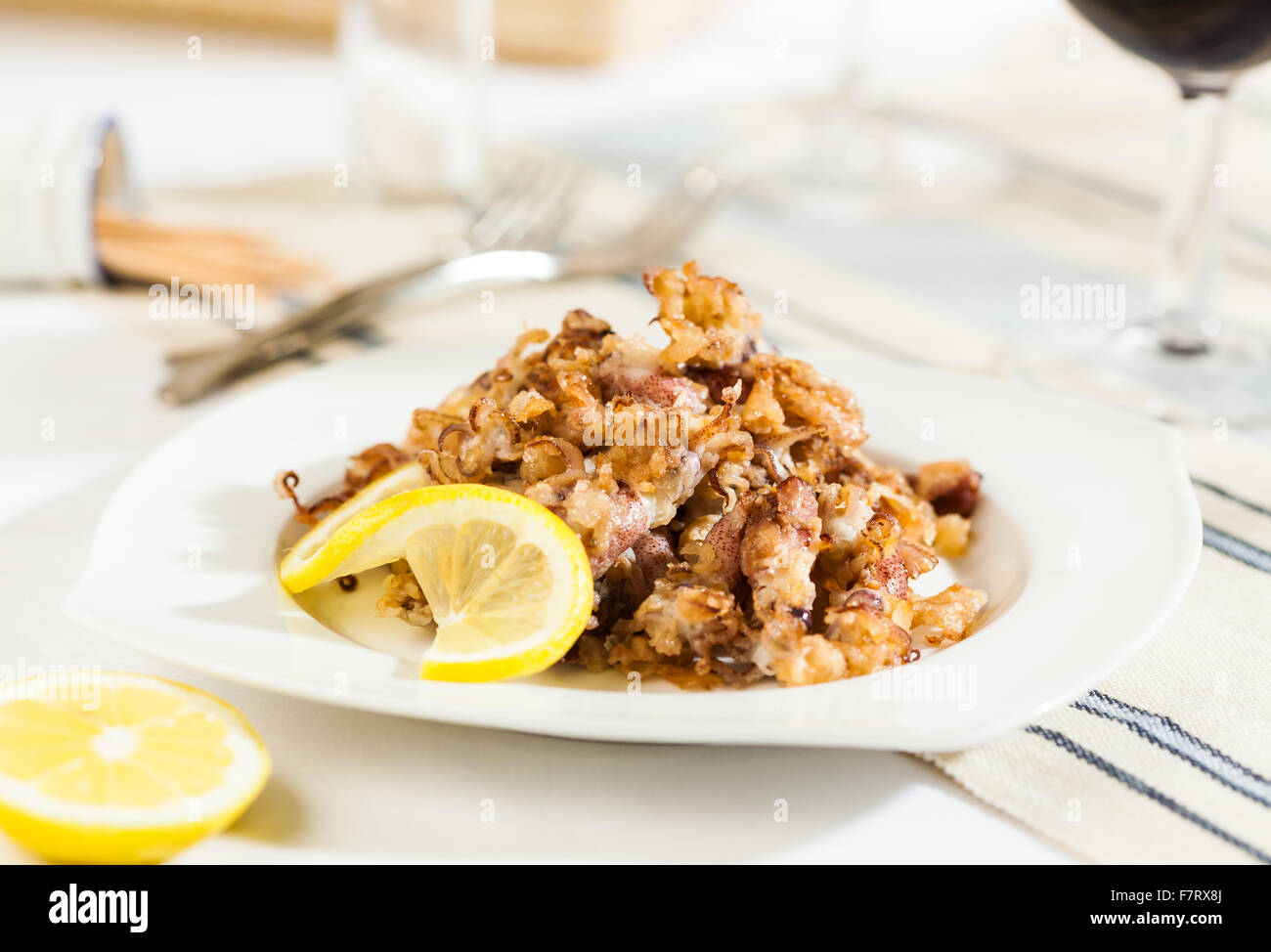 Fried squid typical Spanish tapa - Stock Image
