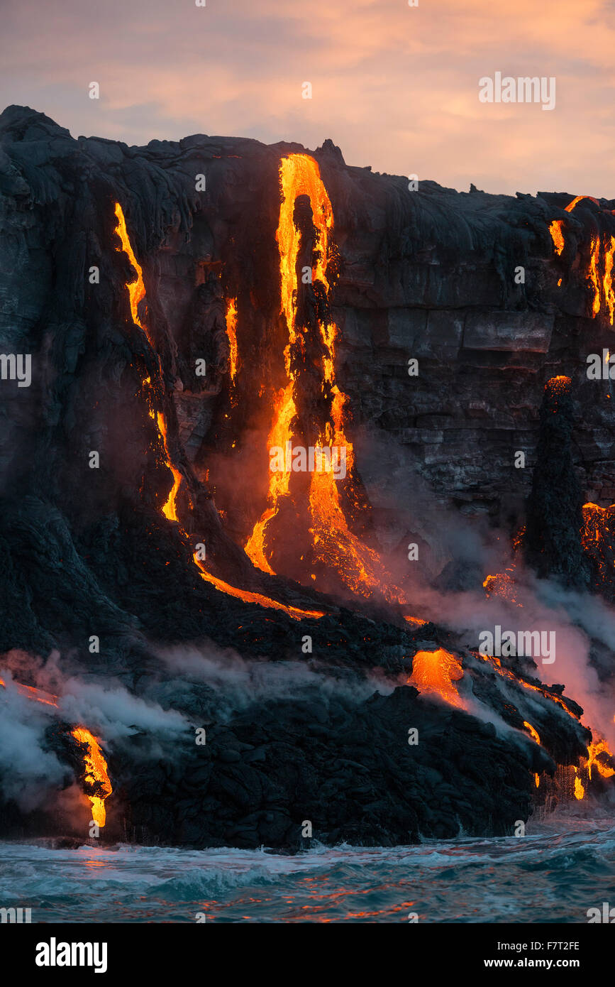 red hot lava from Kilauea Volcano enters the Pacific Ocean at sunrise on Hawaii Island ( the Big Island ), west - Stock Image