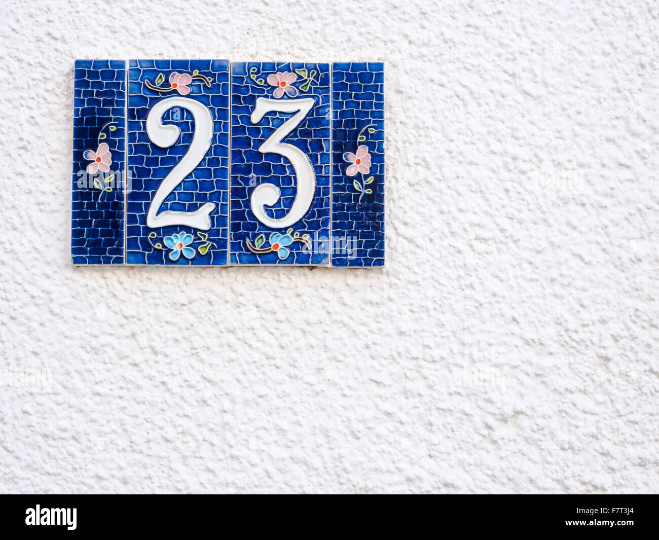 Street number 23. Particular of artistic street number - Stock Image
