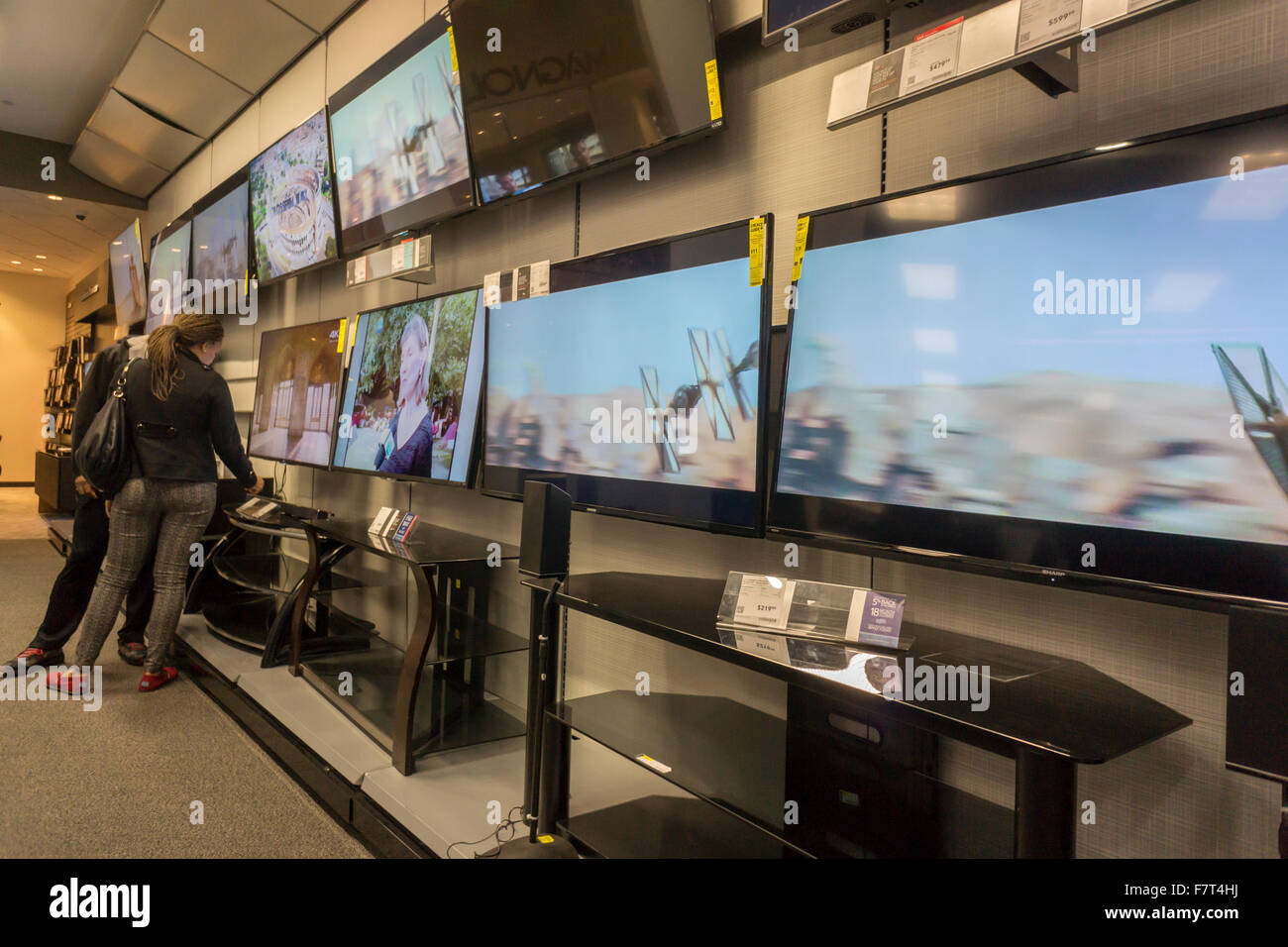 Customers browse Samsung 4K Ultra High Definition televisions in a Best Buy electronics store in New York on Sunday, - Stock Image