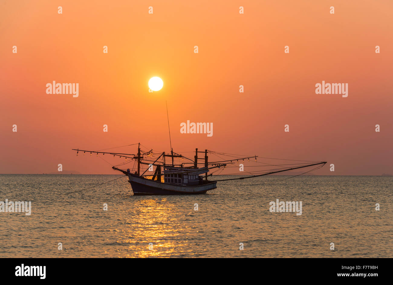Boat in the sea at sunset, Koh Samui, Gulf of Thailand, Thailand - Stock Image
