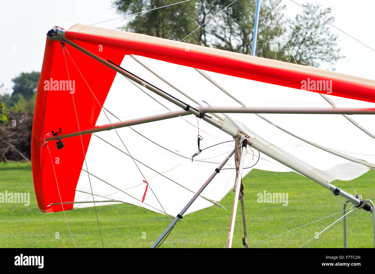 hang glider wing or sail airframe or triangle control frame and harness stationary on ground - Stock Image