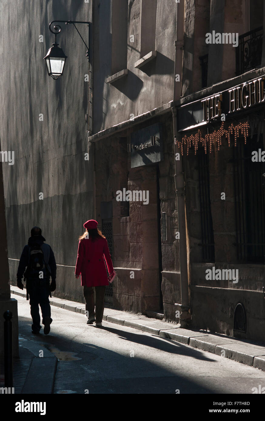 France, Paris, Woman and man walking down medieval street on the left bank - Stock Image