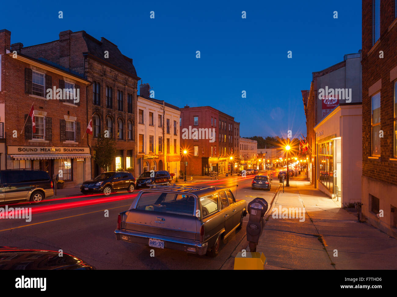 Walton Street with a Rambler Ambassador in the foreground in downtown Port Hope at dusk. Ontario, Canada. Stock Photo