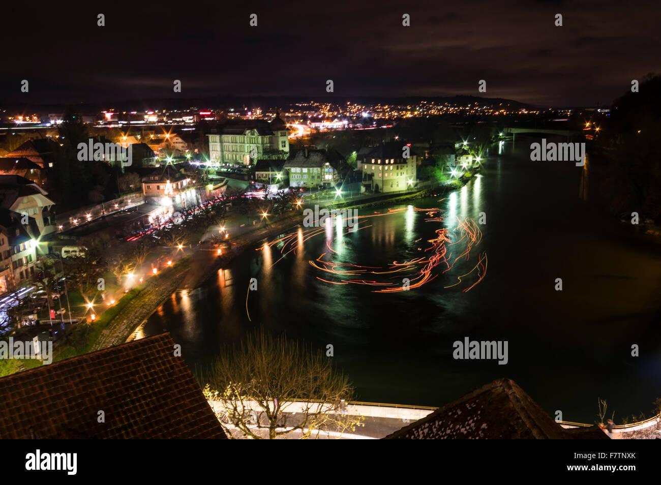 Waterfront of the town of Aarburg, Switzerland, at night, during the 'Aarburg leuchtet' Christmas event. - Stock Image