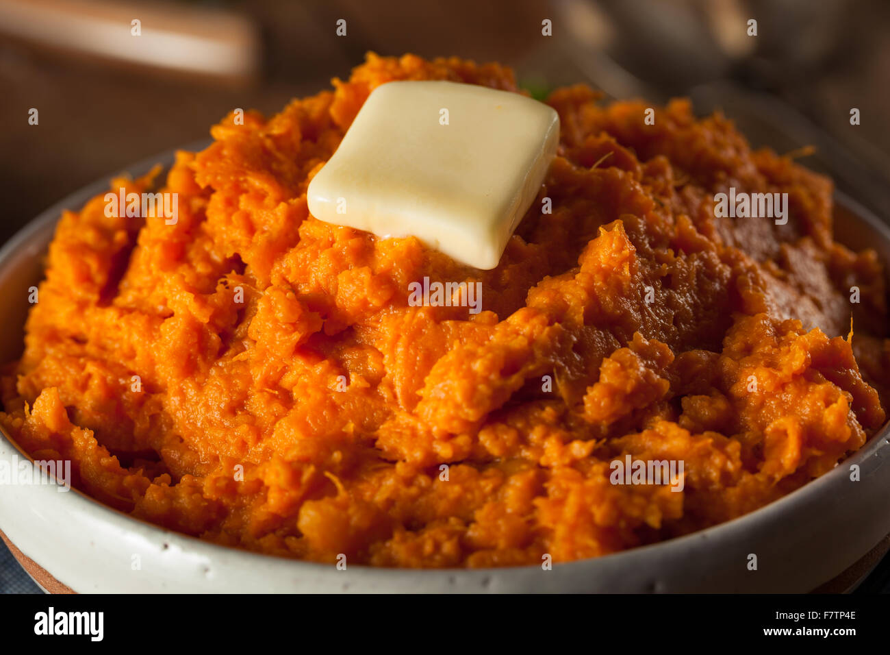 Organic Homemade Mashed Sweet Potatoes with Butter Stock Photo