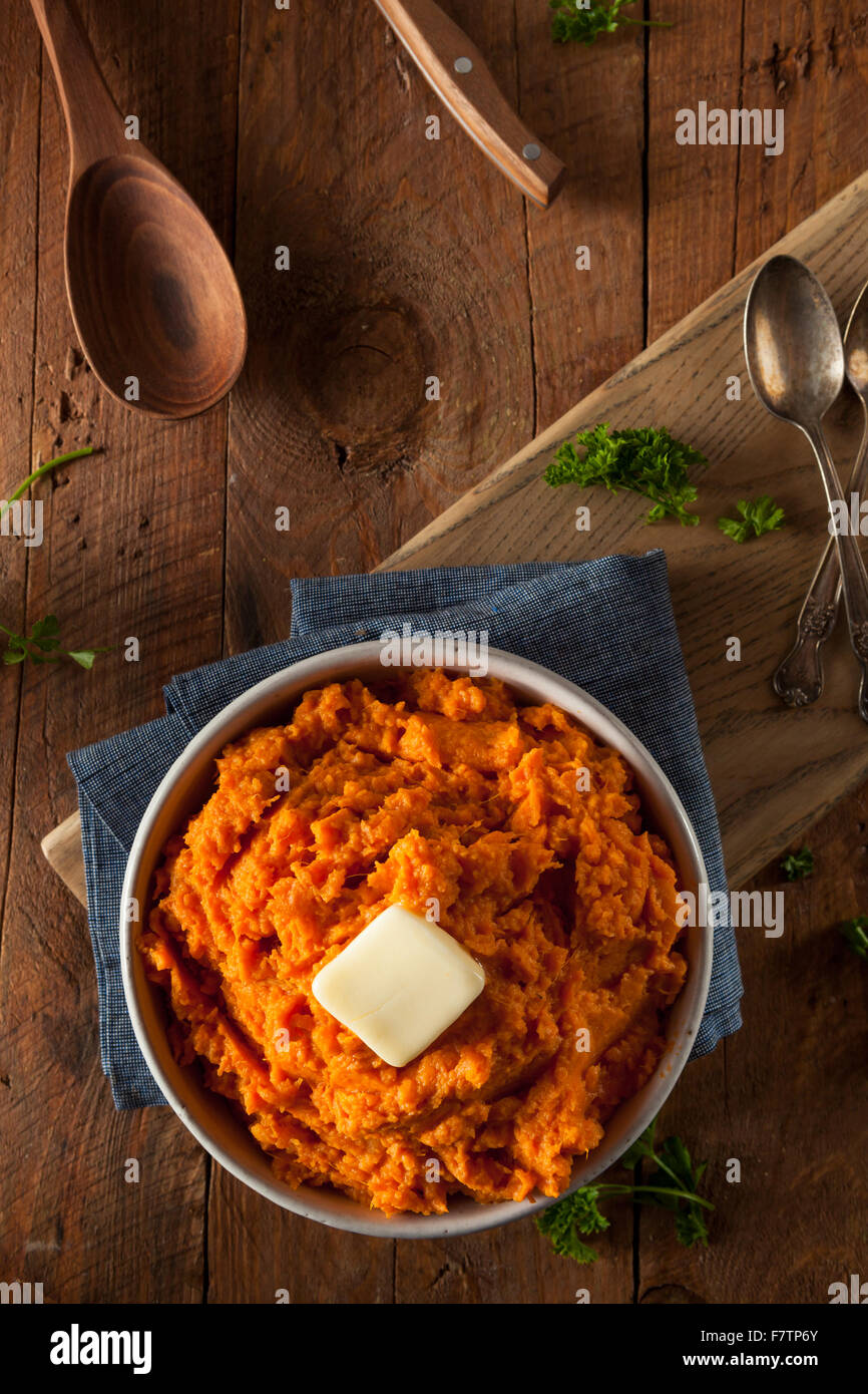 Organic Homemade Mashed Sweet Potatoes with Butter - Stock Image
