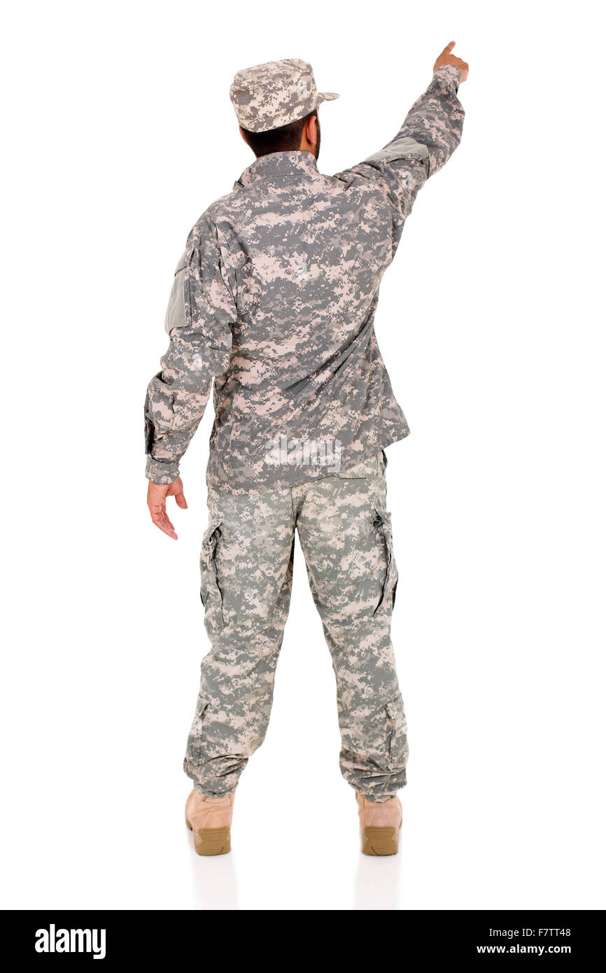 rear view of military serviceman pointing empty space - Stock Image