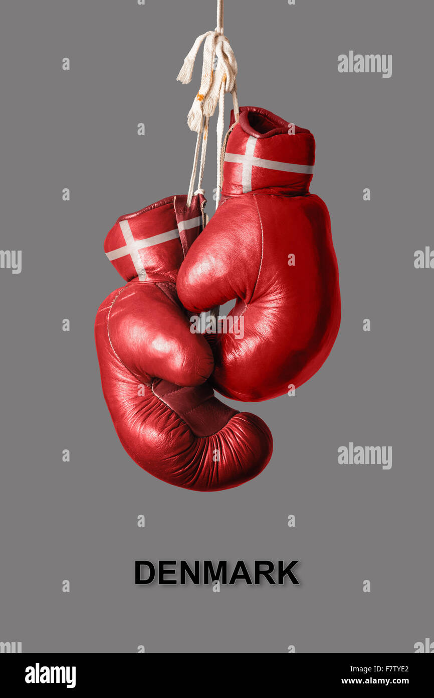 old Boxing Gloves in the Color of Denmark - Stock Image