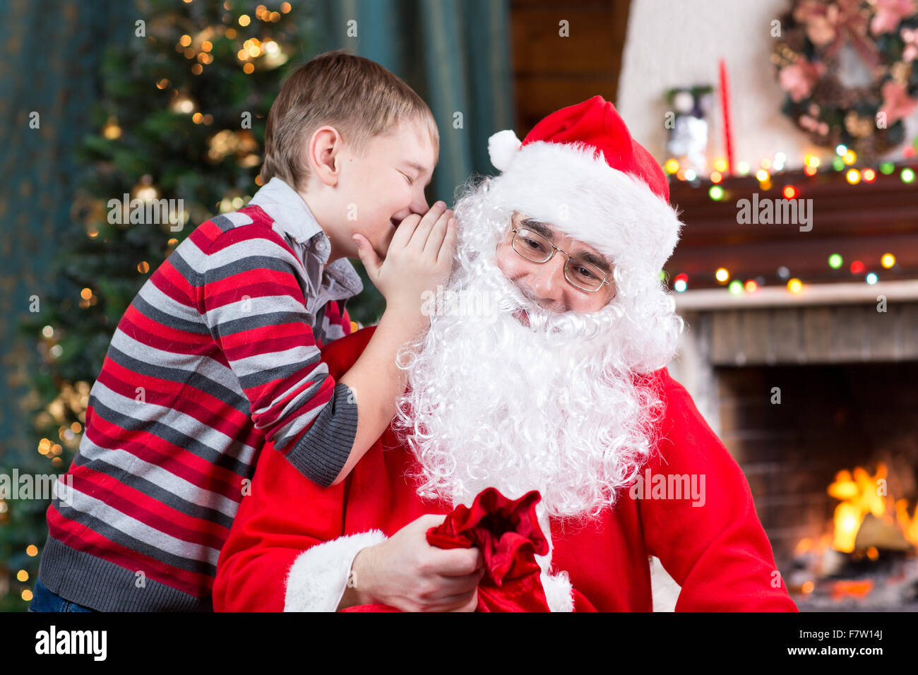 The Christmas Wish.Santa Claus And Child Boy Kid Telling His Christmas Wish In