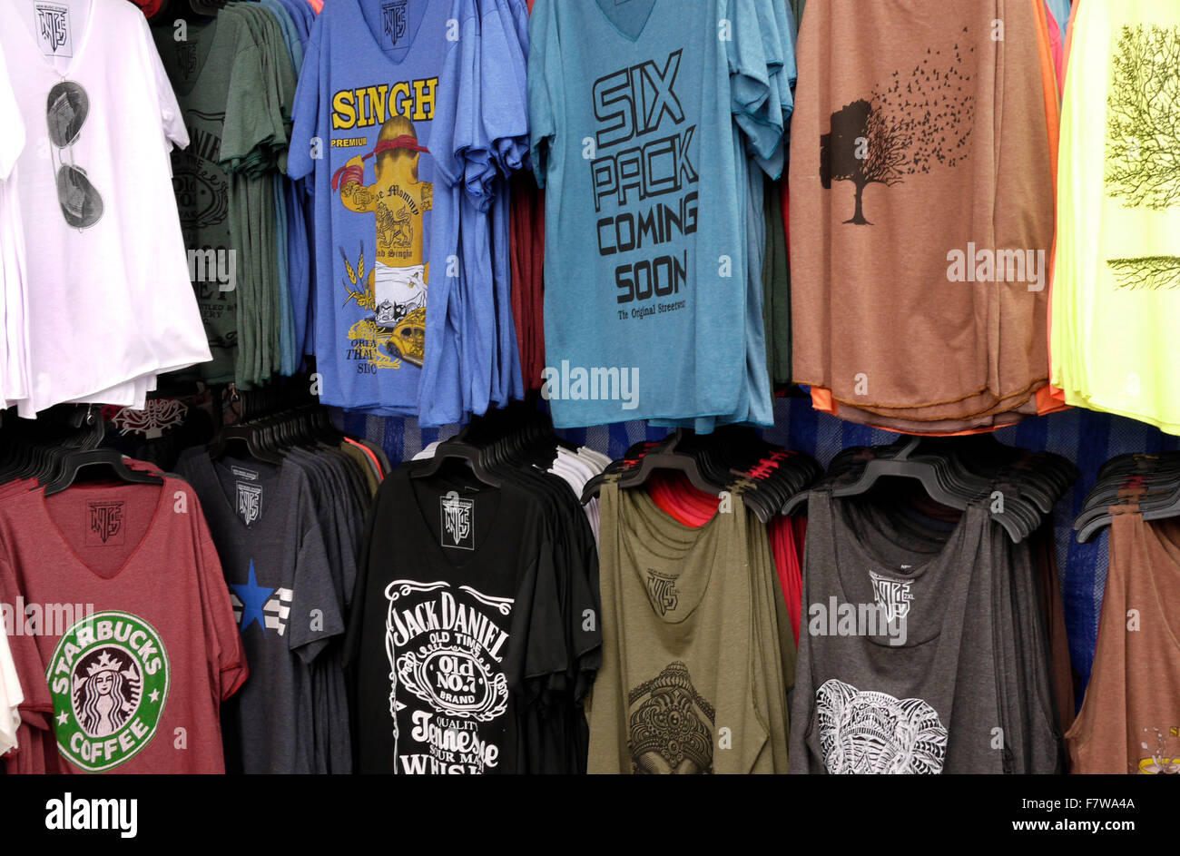 9589d5117d2 T Shirts for sale on a market stall in Pattaya Thailand Stock Photo ...