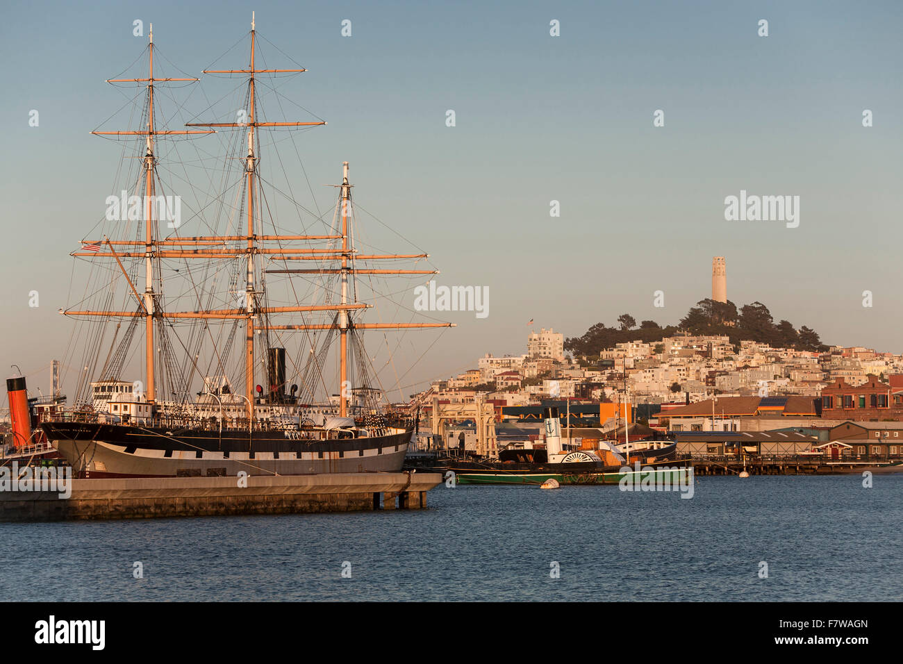 United States, California , San Francisco, The square rigged sailing ship 'Balcutha', Coit Tower on top - Stock Image