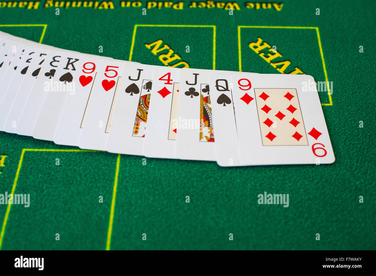 French cards for Texas hold 'em on casino table poker gambling game bet risk - Stock Image