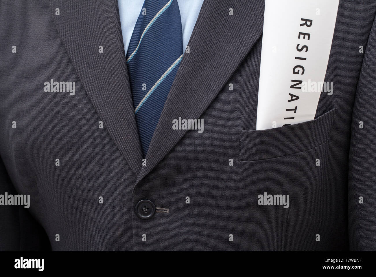 Folded letter of resignation, put in a jacket's pocket of a man. - Stock Image