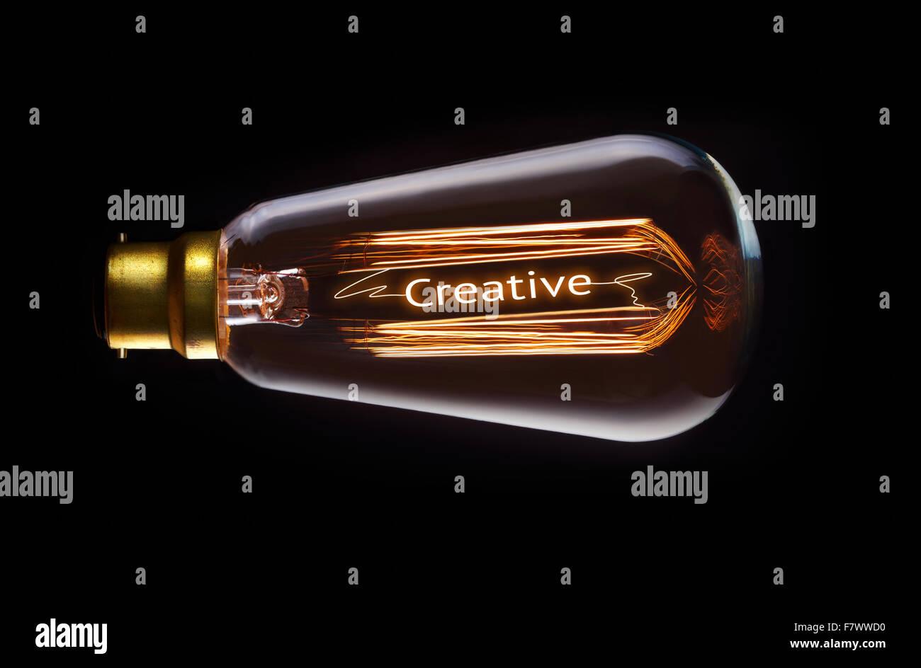 Creative concept in a filament lightbulb. Stock Photo