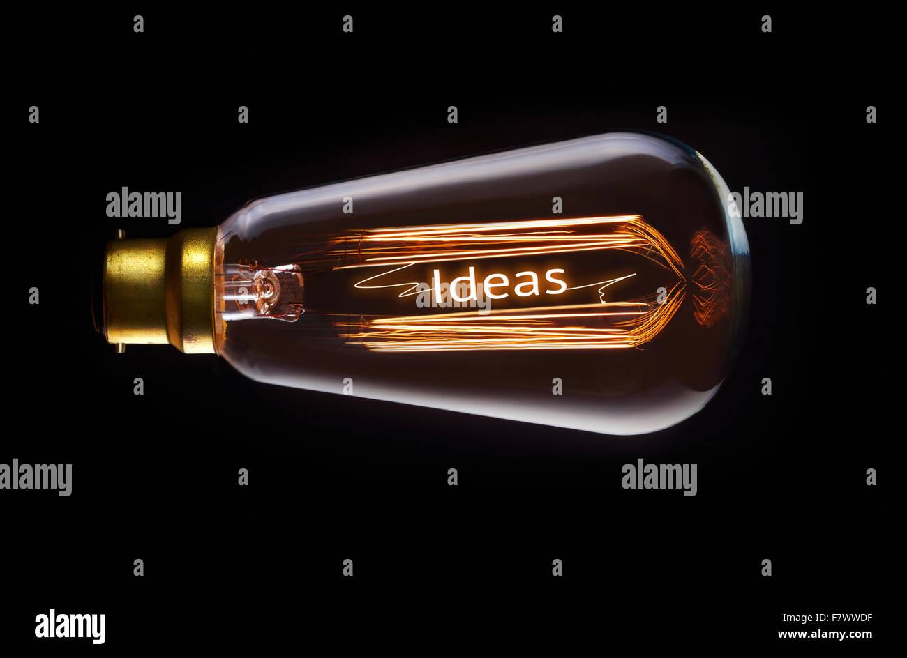 Ideas concept in a filament lightbulb. Stock Photo