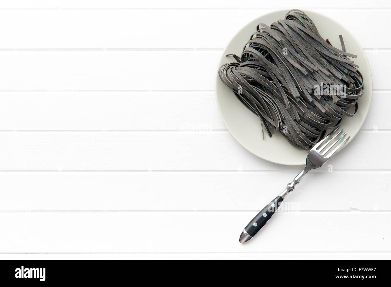 black uncooked noodles with squid sepia ink Stock Photo