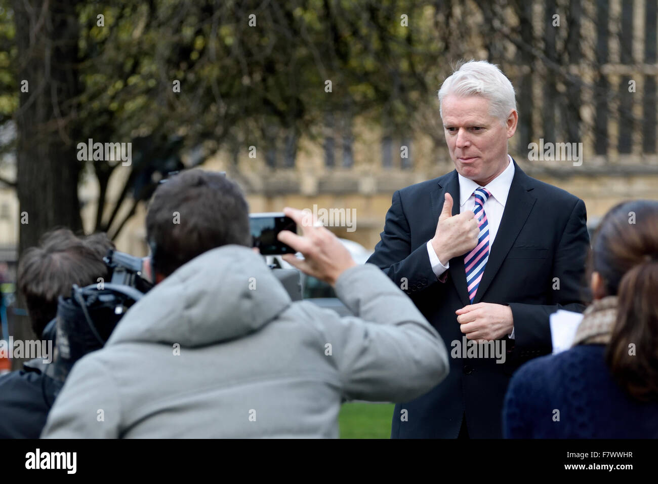Clive Mason, deaf British TV presenter, using sign language to camera in an outside broadcast in London, 2015 - Stock Image