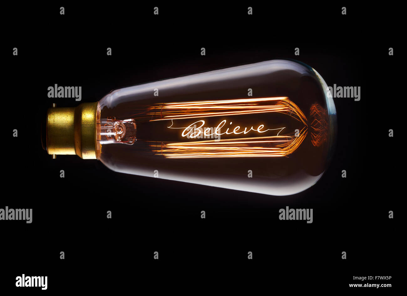 Religion, believe concept in a filament lightbulb. - Stock Image