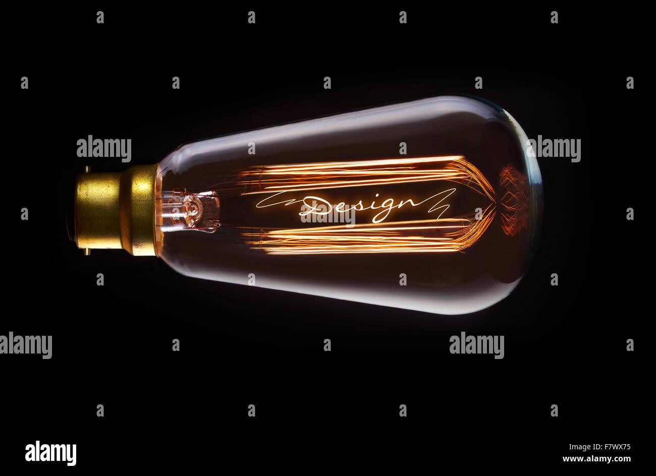 Design concept in a filament lightbulb. - Stock Image